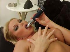 Smoking hot blonde milf rubs wet pussy on the sofa