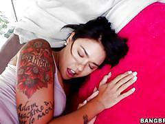 Tattooed asian milf sucks big black cock