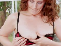 Redhead milf uses a dildo on her pussy