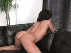 Hot brunette plays with pussy on couch