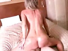 Blonde cougar with young guy