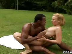 Naughty young blonde chick endures raging black cock outdoors