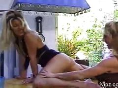 Two blonde lesbians in furious pussy licking outside