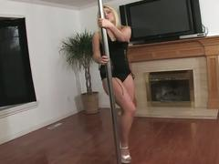 Cute blonde pole dances, strips, and plays with pussy
