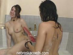 Sexy coed lesbians toy pussy in bathtub