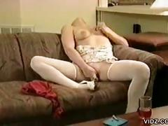 Blonde gives herself orgasm with dildo