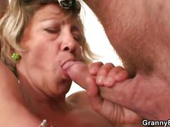 Horny after a party, dude gets mature cleaning lady to blow him