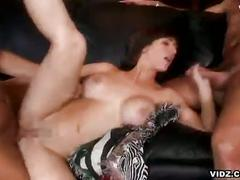 Big tit brunette enjoys two big cocks in pussy and mouth