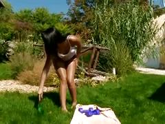 Brunette hottie masturbates wet pussy in the backyard