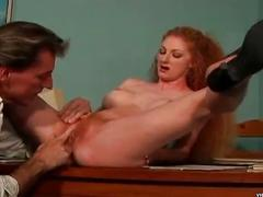 Redhead babe with a bush of orange pubic hair fingered