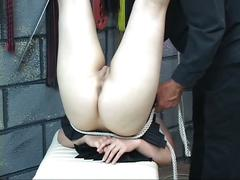 Cute young bdsm brunette with perky tits is roped up and hung upside down