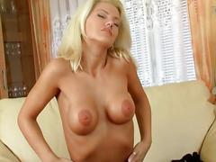 Big tits blonde in stockings fingers and toys pussy