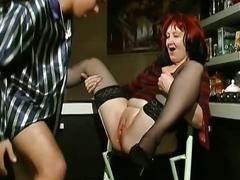 Redhead milf in stockings and heels gets fucked