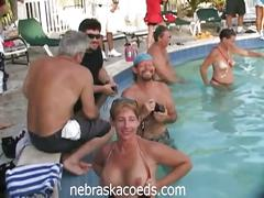 Coeds at a naked pool party on spring break
