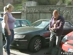 Plump blonde gives head in a car