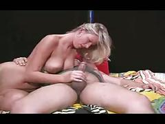 Blonde  gives a great handjob