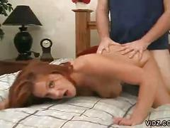 Perky redhead gets drilled from behind