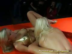 Lesbian porn action on public show stage