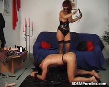 Slutty redhead drips wax on guys ass