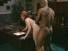 Redhead blows and bangs a big black cock