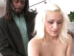 Hot blonde taking a big black cock deep in her  pussy