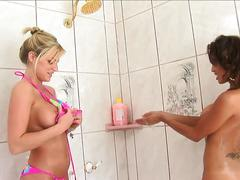 Brooke belle and renae cruz play in the shower and toy on a couch