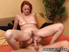 Amateur redhead milf gets young stud to bang
