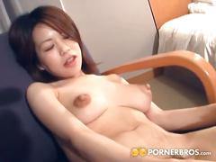 Big tits japanese hairy babe pleasures herself.