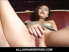 Japanese milf toying trimmed pussy with vibrator
