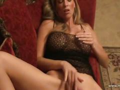 Big breasted blonde milf plays solo on her couch