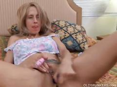 Sexy blonde mil fucking a dildo solo.