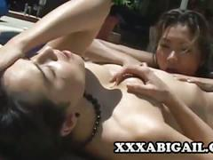 Horny lesbians having sex by the pool.