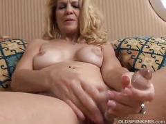 Horny blonde milf masturbating.