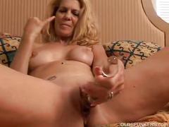 Horny blonde milf masturbating.
