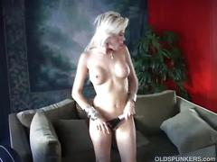 Sexy blonde milf fingering her pussy.