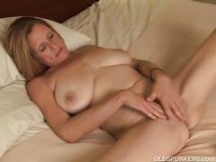 Cute milf rubbing her pussy so hard.