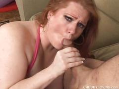 Chubby redhead with big tits gives him head