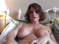 Busty mature brunette shaves and toys pussy