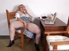 Blonde milf getting horny talking on the phone.