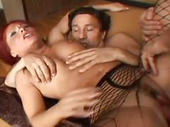 Horny dudes double penetrating one nasty redhead chick