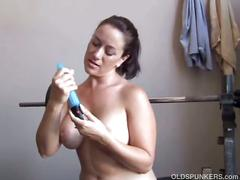 Hot milf drills pussy in a gym workout