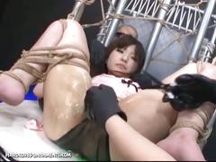 Tied up japanese babe forced to cum