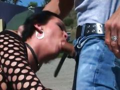 Cock sucking brunette biker gets ass fucked
