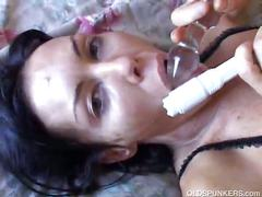 Sexy brunette fucking her self with a dildo.