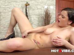 Pretty brunette playing with shaved pussy