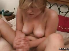Busty blonde slut pampers rock-hard cock