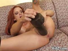 Sexy redhead assdrilled by big dildo