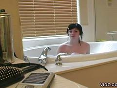 Pretty white youngster naked in the tub