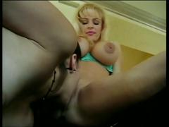 Leggy brunette lesbian sucks and fingers bent-over d-cup blonde hottie's cunt