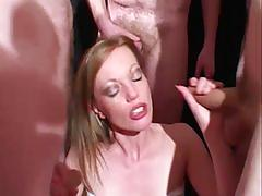 Holly kiss sucks dick and takes facials in a bukkake party